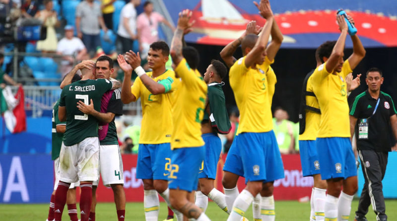 Soccer Football - World Cup - Round of 16 - Brazil vs Mexico - Samara Arena, Samara, Russia - July 2, 2018  Mexico's Carlos Salcedo and Rafael Marquez react after the match                     REUTERS/Michael Dalder
